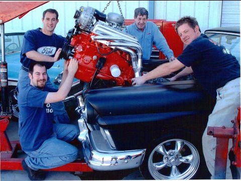 Family with car engine