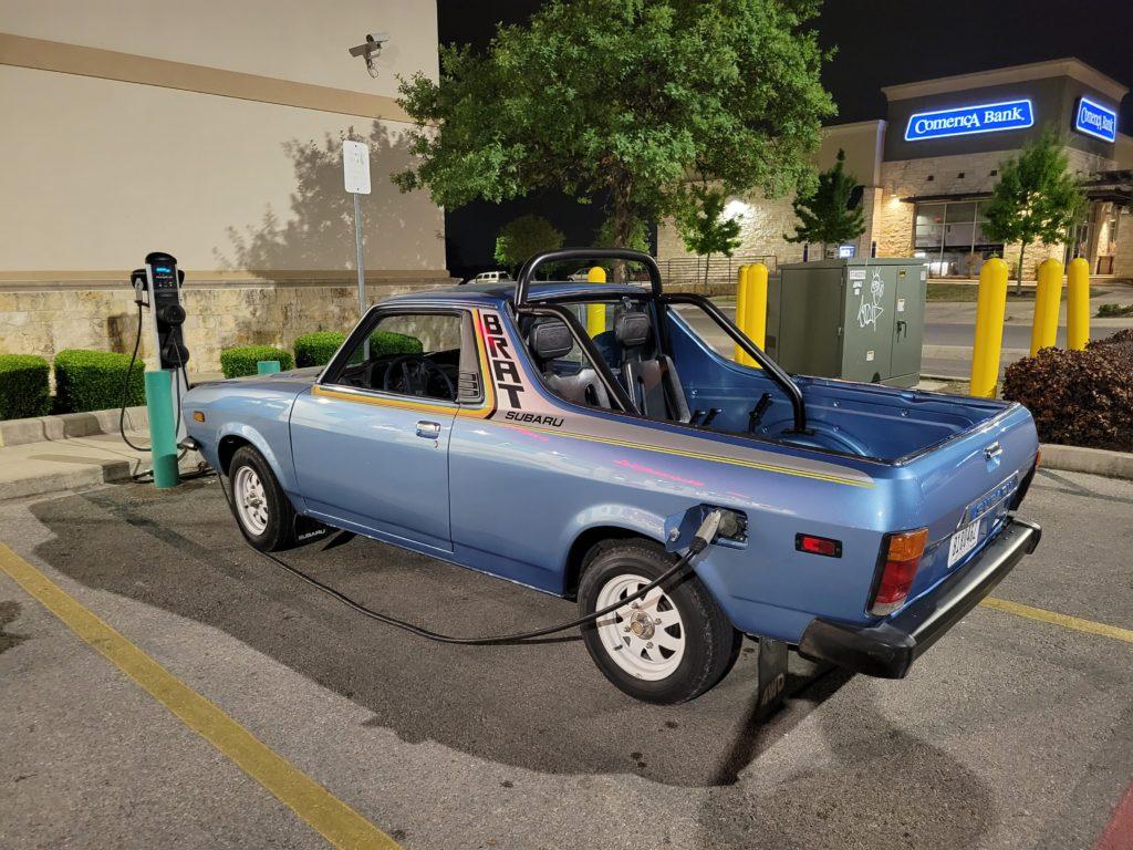 1980 Subaru EV Brat at public charging station